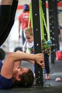 Baby watching mom workout at CrossFit 405 South