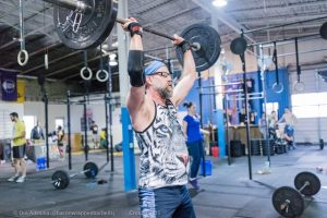 Picture of Doug pushing a barbell overhead.